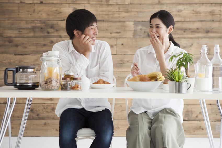 Newlywed couple is eating breakfast together