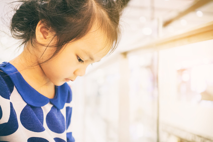 Lonely Asian baby girl with bright copy space