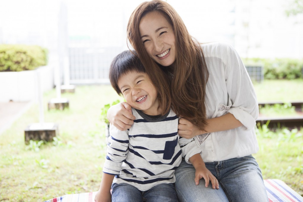 Mom and son have a full smile